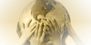 hands holding up globe of the earth